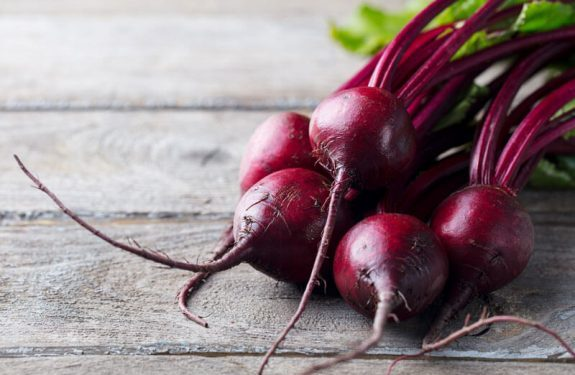 Fresh organic beet, beetroot. Grey rustic wooden background. Close up.
