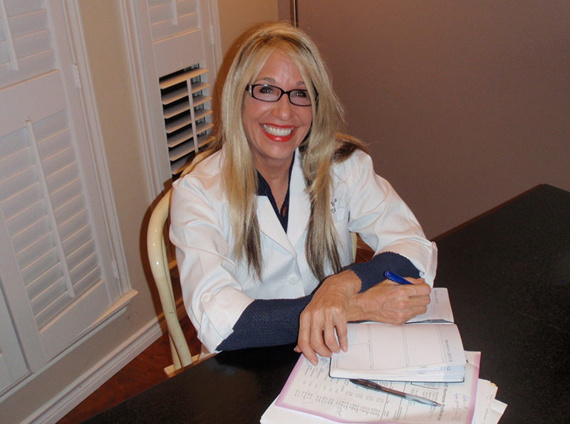 Lindsey pic in office-white jacket paperwork